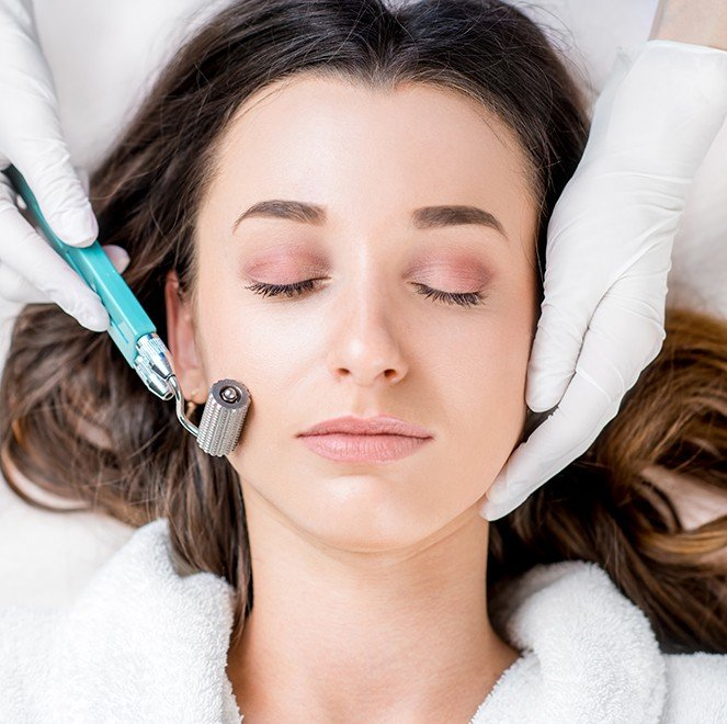 Woman receiving P R F microneedling treatment