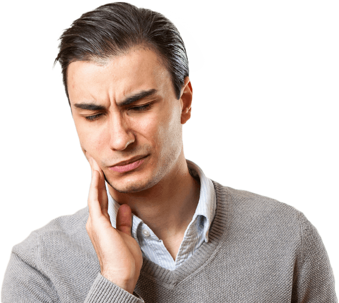 Man in need of emergency dentistry holding cheek