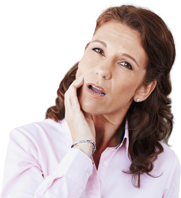 Woman in need of TMJ therapy holding cheek