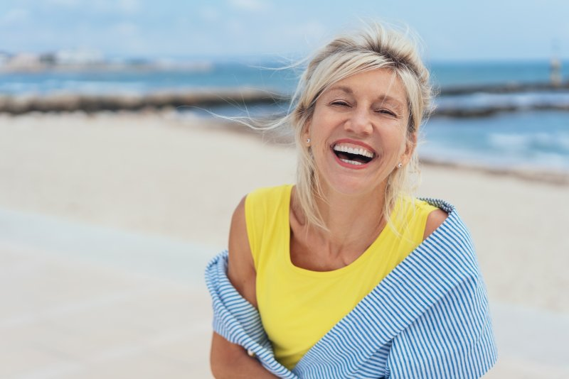 Mature woman smiling on the beach