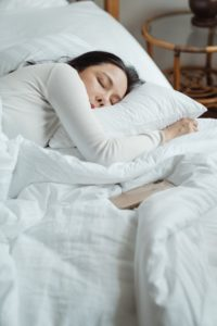 Sleeping woman using tips from sleep dentist